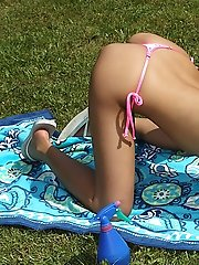 Anastasia Oiled Up, Tanning in Bikini - 10/6/2010